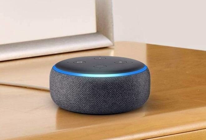 An Amazon Echo Dot 3rd Generation on a table