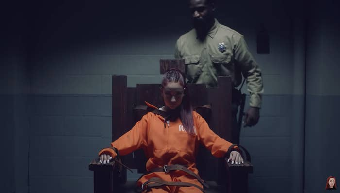 """Bhad Bhabie sitting in the electric chair in her """"Hi Bich"""" music video"""