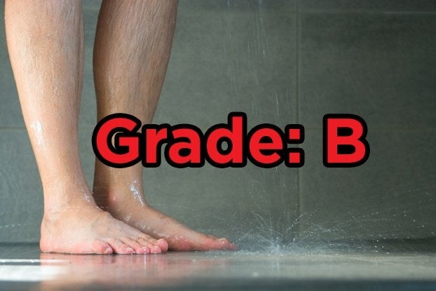 """Feet in a shower with the words """"Grade: B"""""""