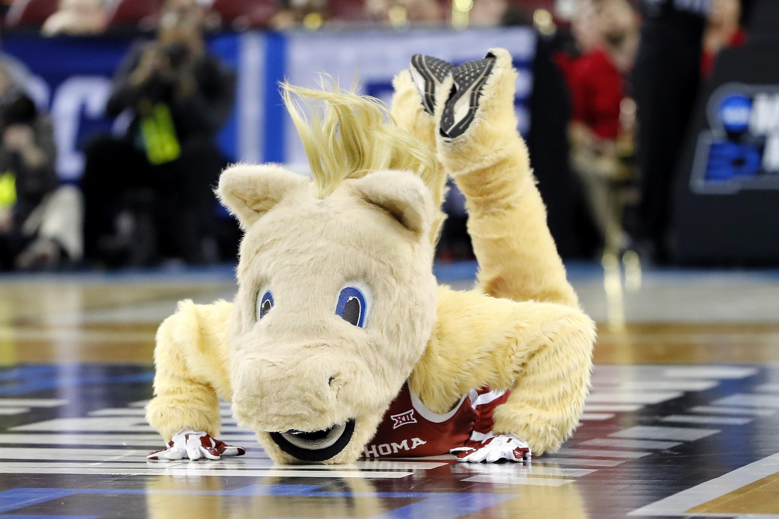 Oklahoma horse mascot doing the worm.