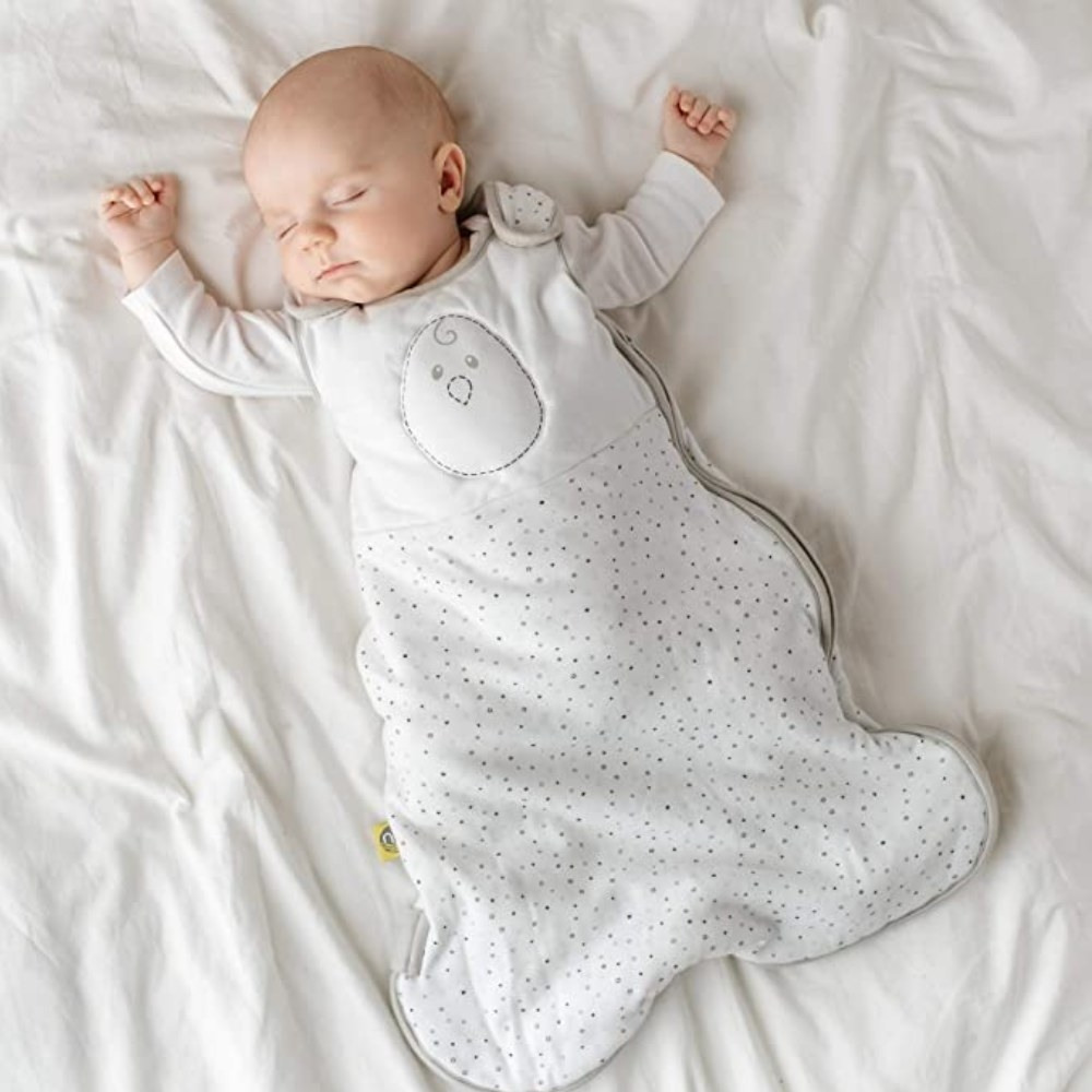 A baby wearing a weighted sleep sack in bed