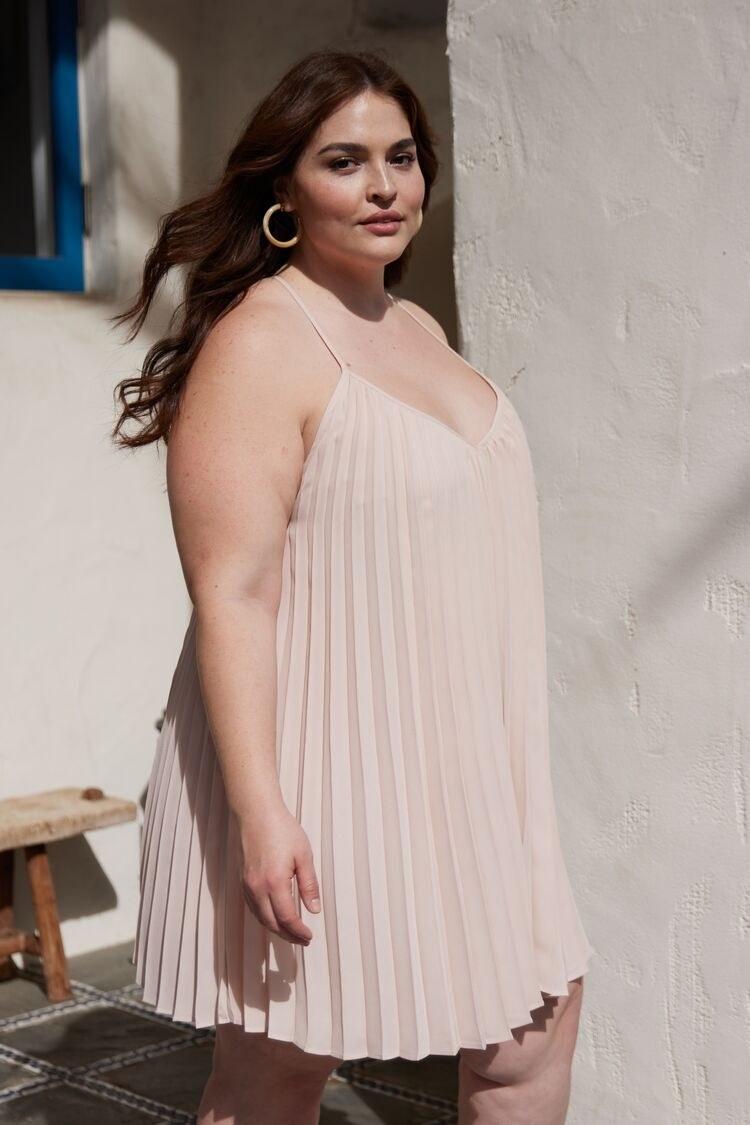model wearing the pale pink mini dress