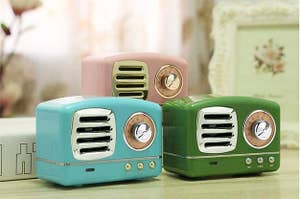 Mini retro-looking radio speakers in blue, green, and pink