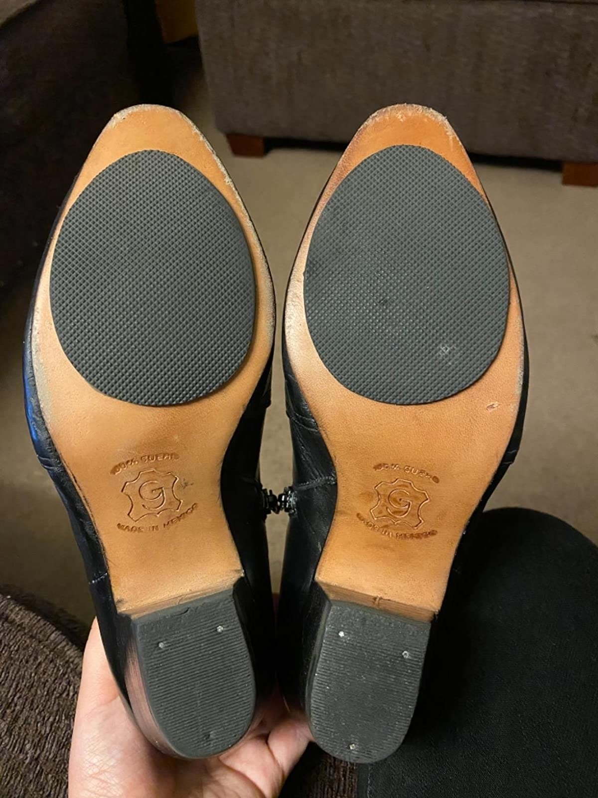 Reviewer showing pads on bottom of shoes