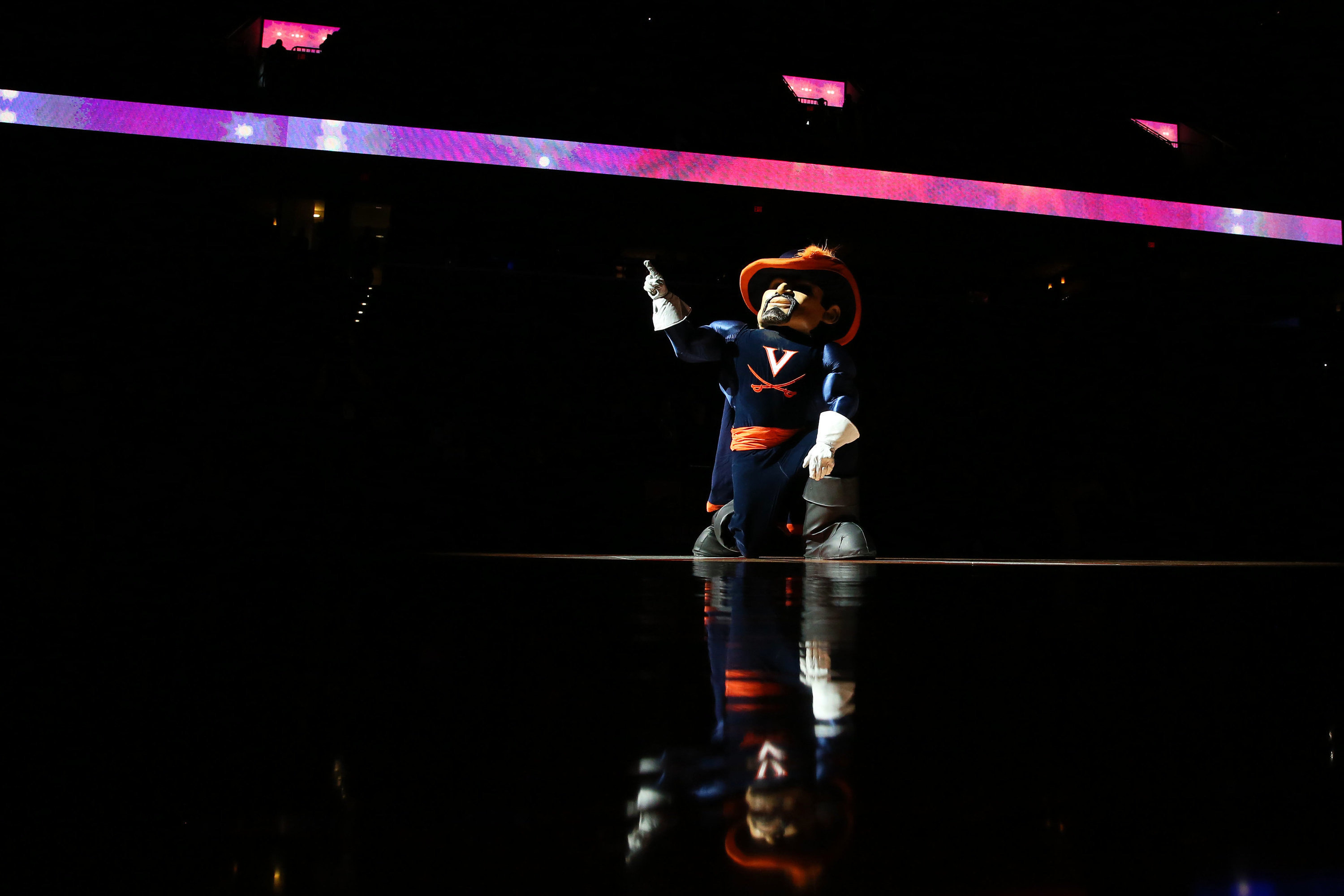 """Virginia mascot with a big """"V"""" on shirt and crossed swords on it."""