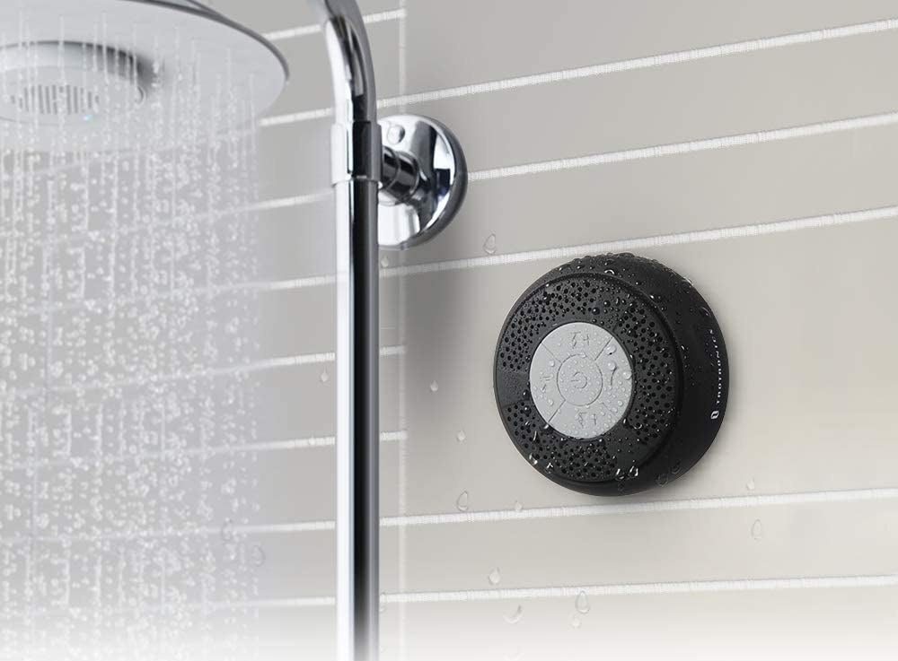 The bluetooth speaker on a wall in a shower