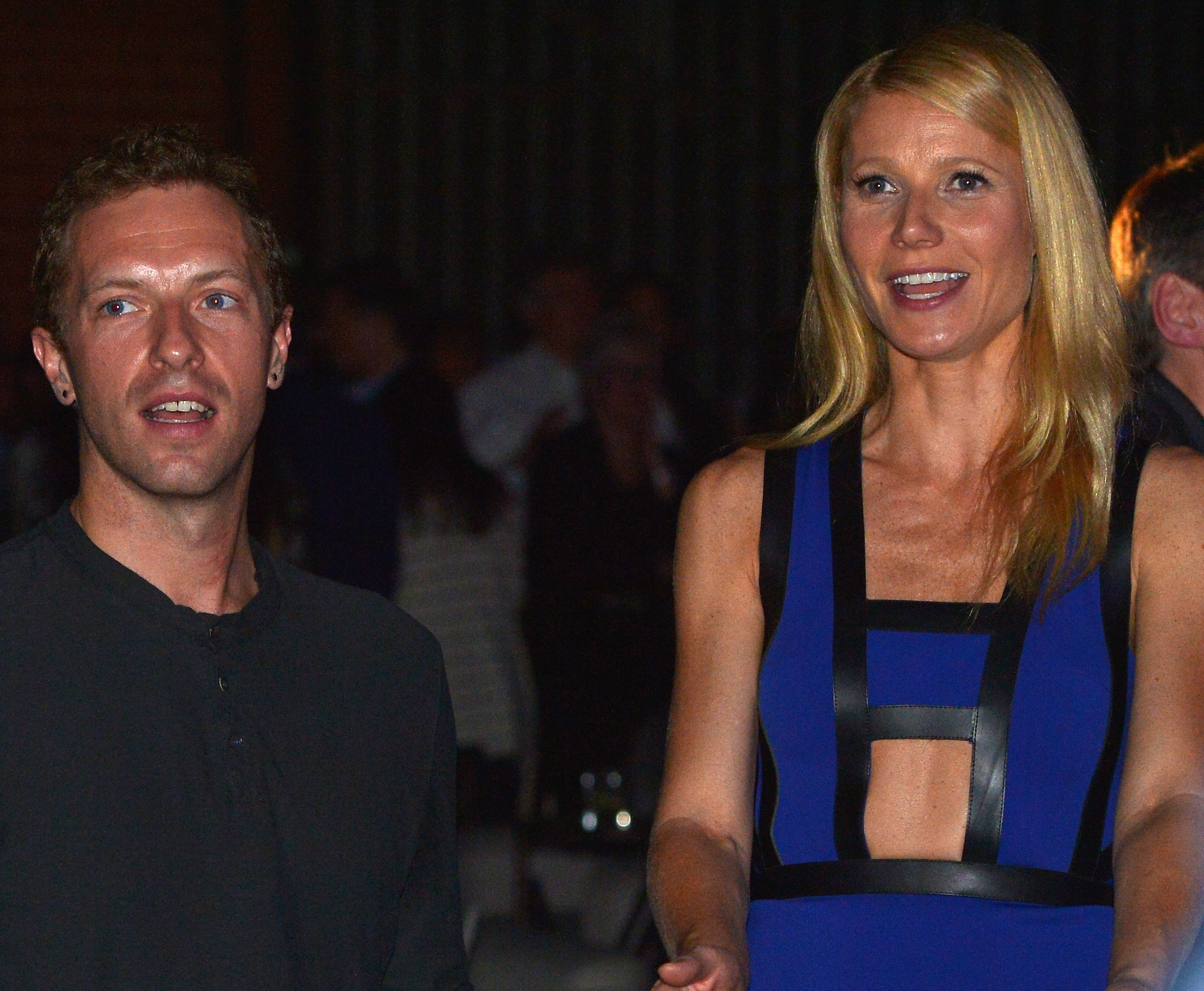 Gwyneth sits next to Chris at an event