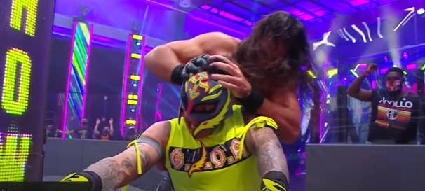 Seth Rollins pushing Rey Mysterio into steel stairs, trying to poke his eye out.