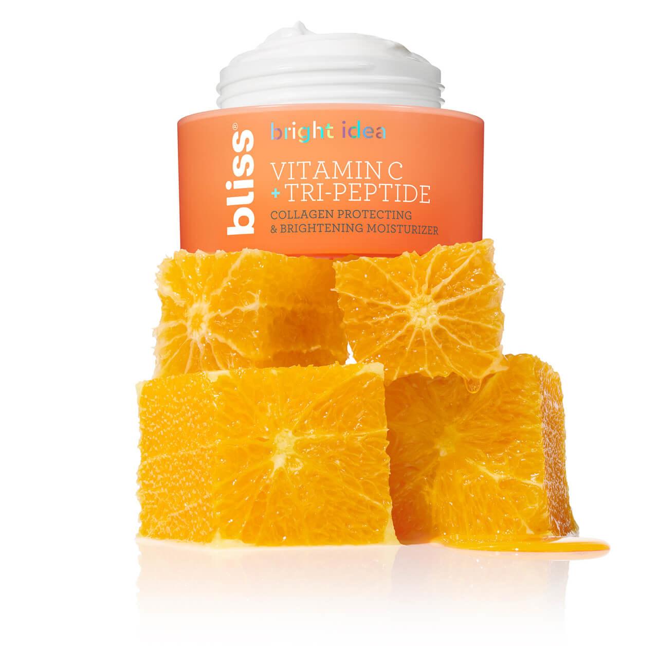 A jar of moisturizer sitting on top of orange chunks