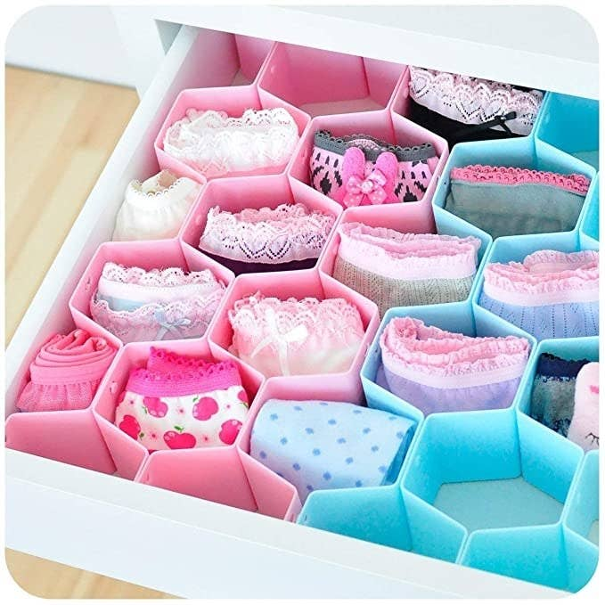 Pink and blue honeycomb organisers with undergarments in them.