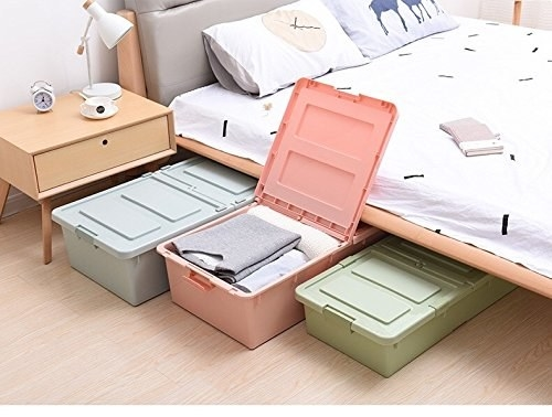 Pastel coloured under the bed storage boxes.
