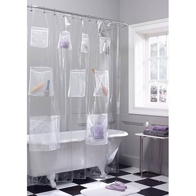 Clear shower curtain with pockets.