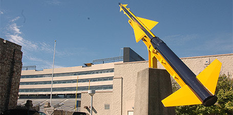 Big yellow and blue rocket pointing toward the sky.