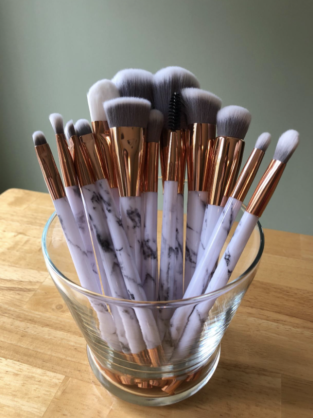 makeup brushes with marble print on the handles