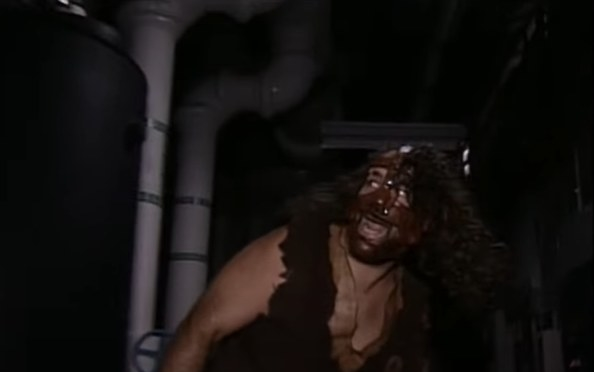 Masked wrestler Mankind lurking in a boiler room.