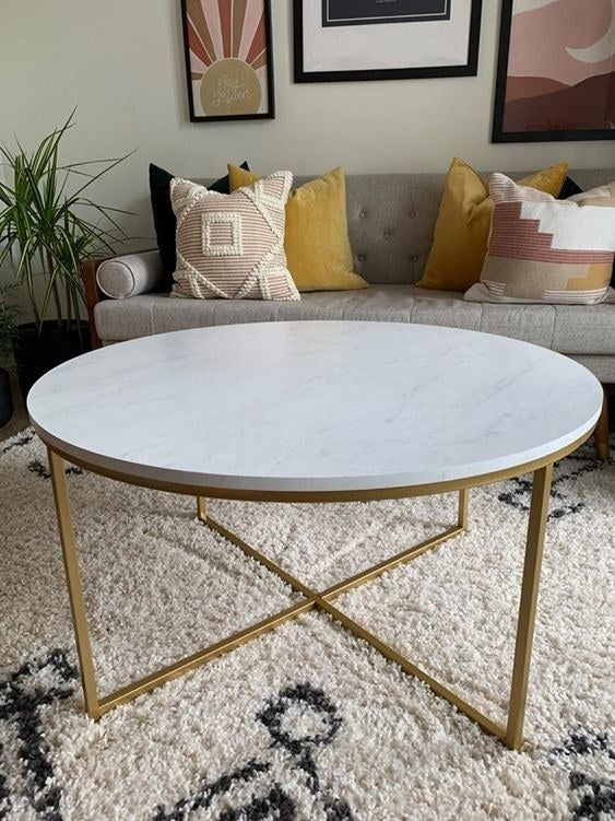 Reviewer's picture of the marble-top round table with gold legs