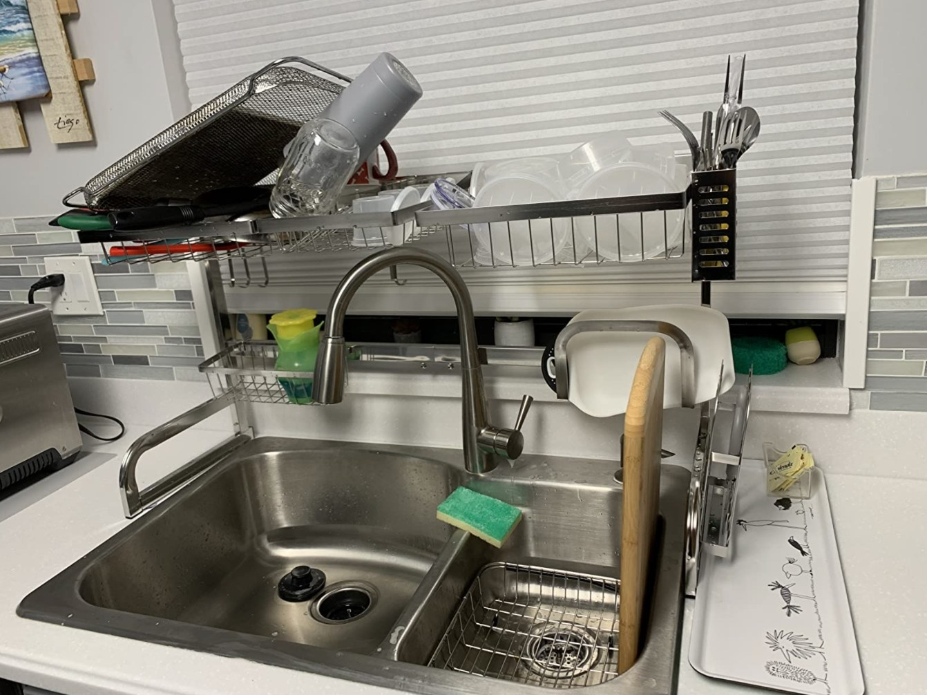 The over the sink drying rack holding dishes