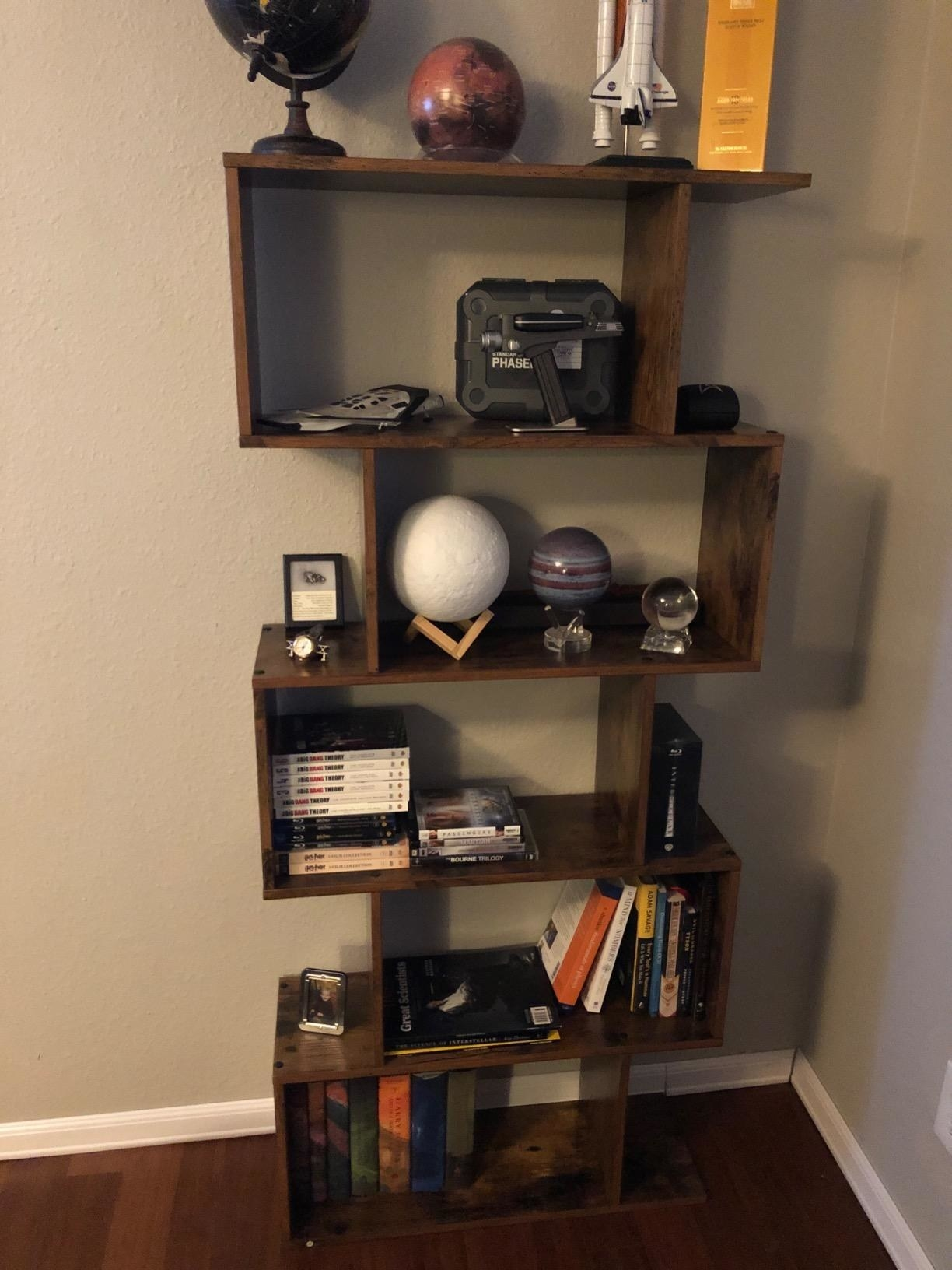 Squiggle shaped bookcase with 5 rectangular compartments in a reviewer's home