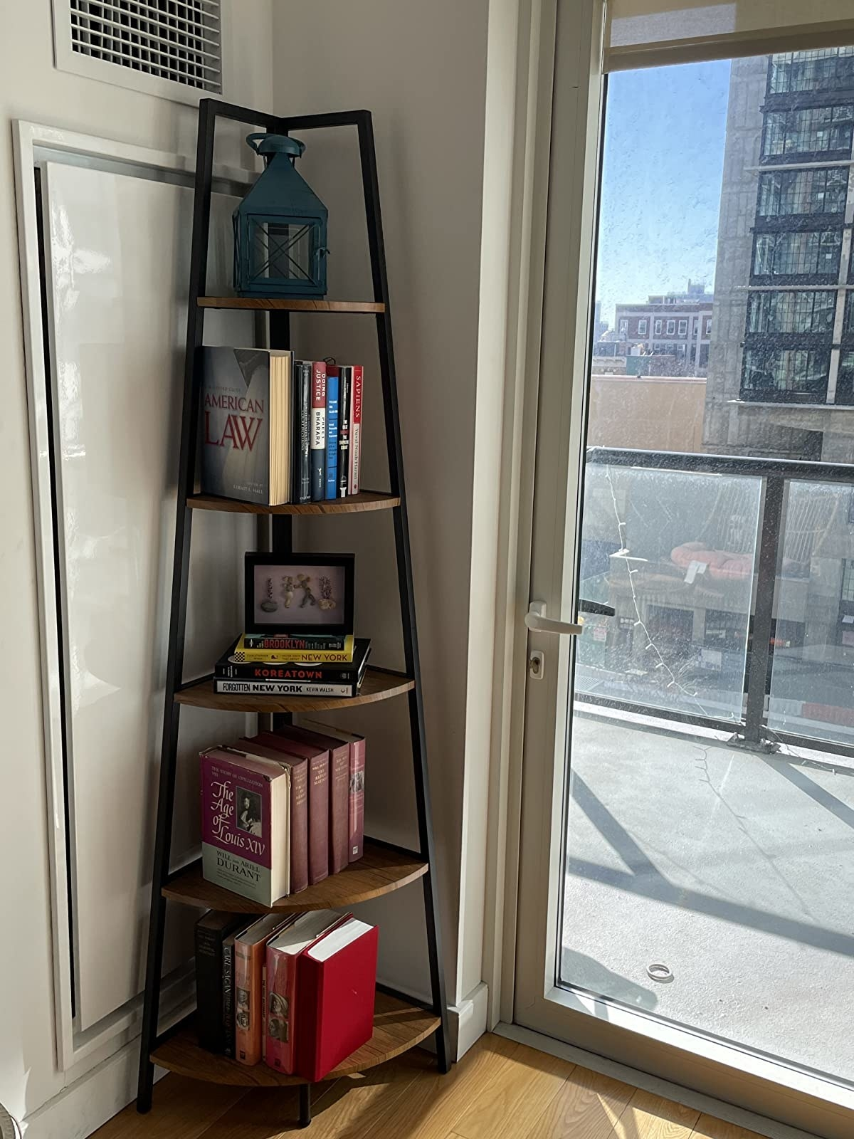tall black and brown bookcase in a corner