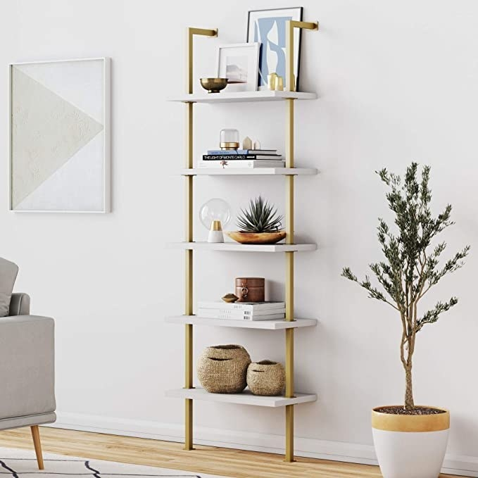 gold and white shelving unit