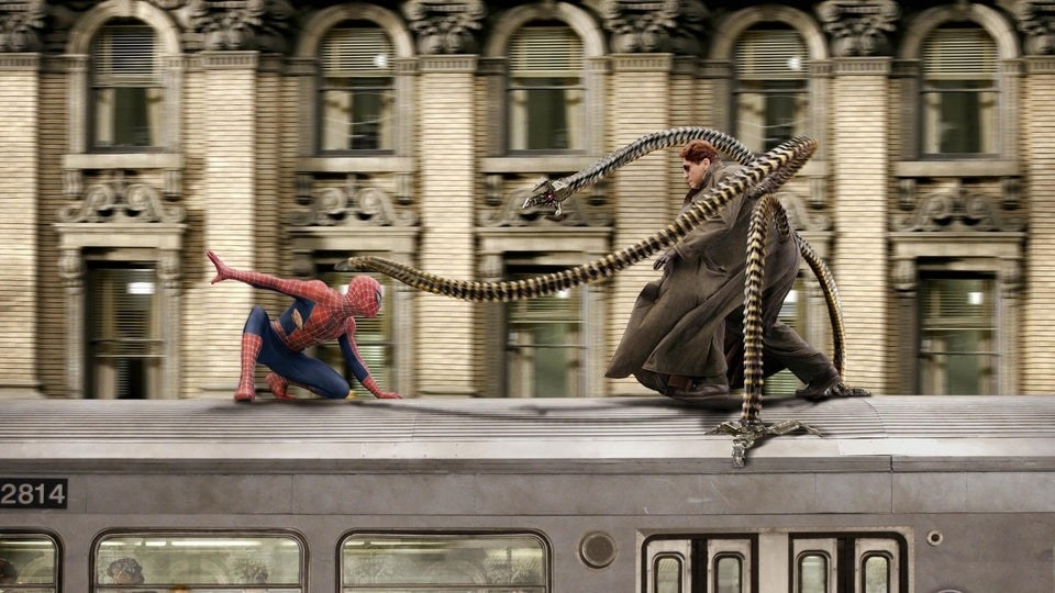 Spiderman and Doctor Octopus fight on top of a moving train