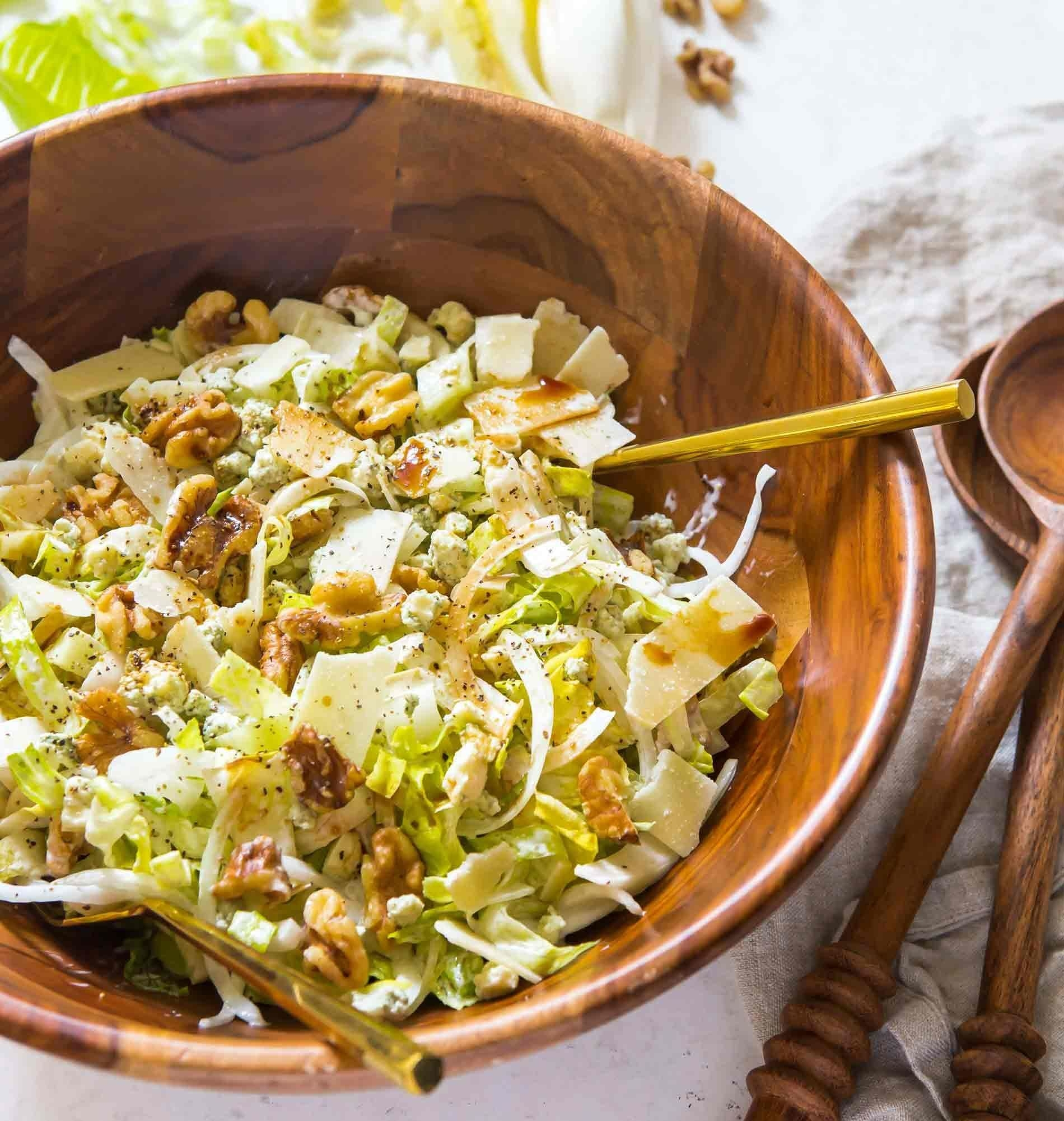 A romaine salad with walnuts, Parmesan, and endive.