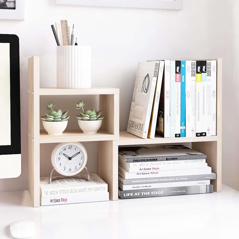 white wood shelving set on a desk