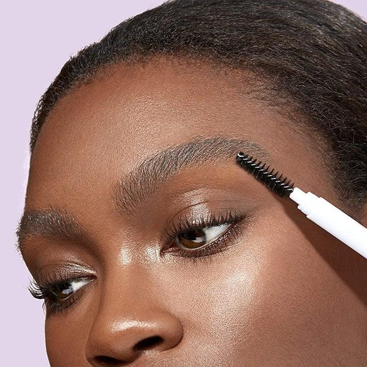 model brushing back her brows