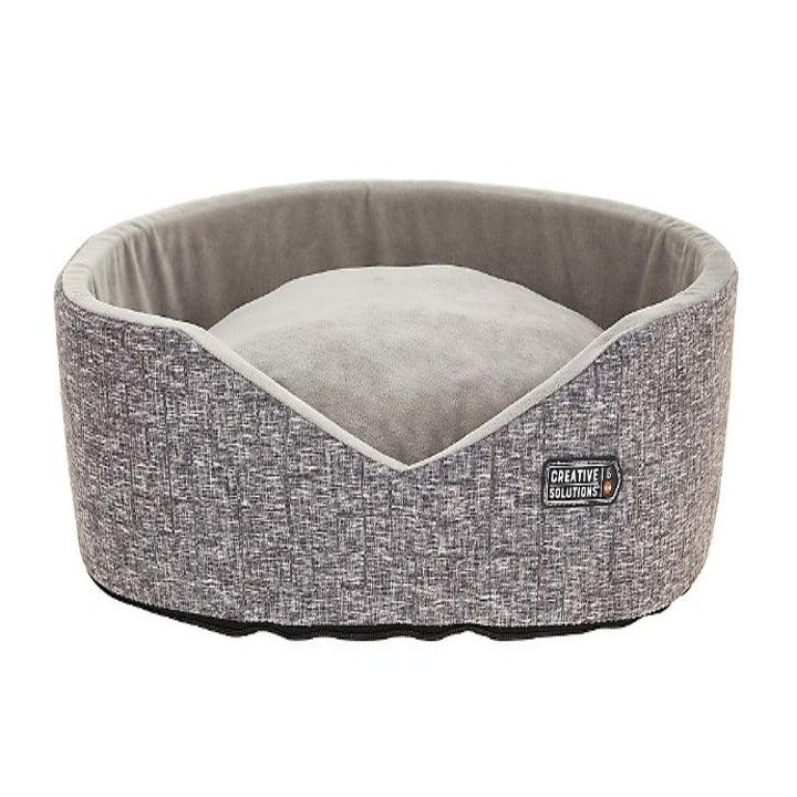 A heated cuddler pet bed