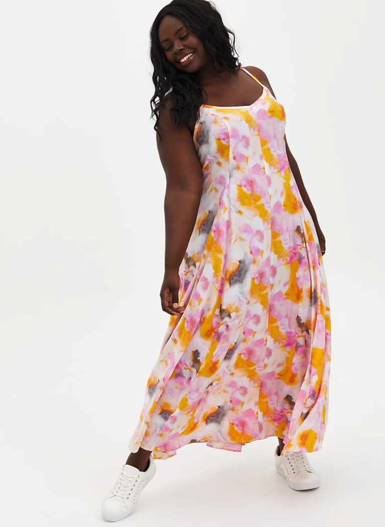 model wearing a sleeveless pink and orange water color maxi dress