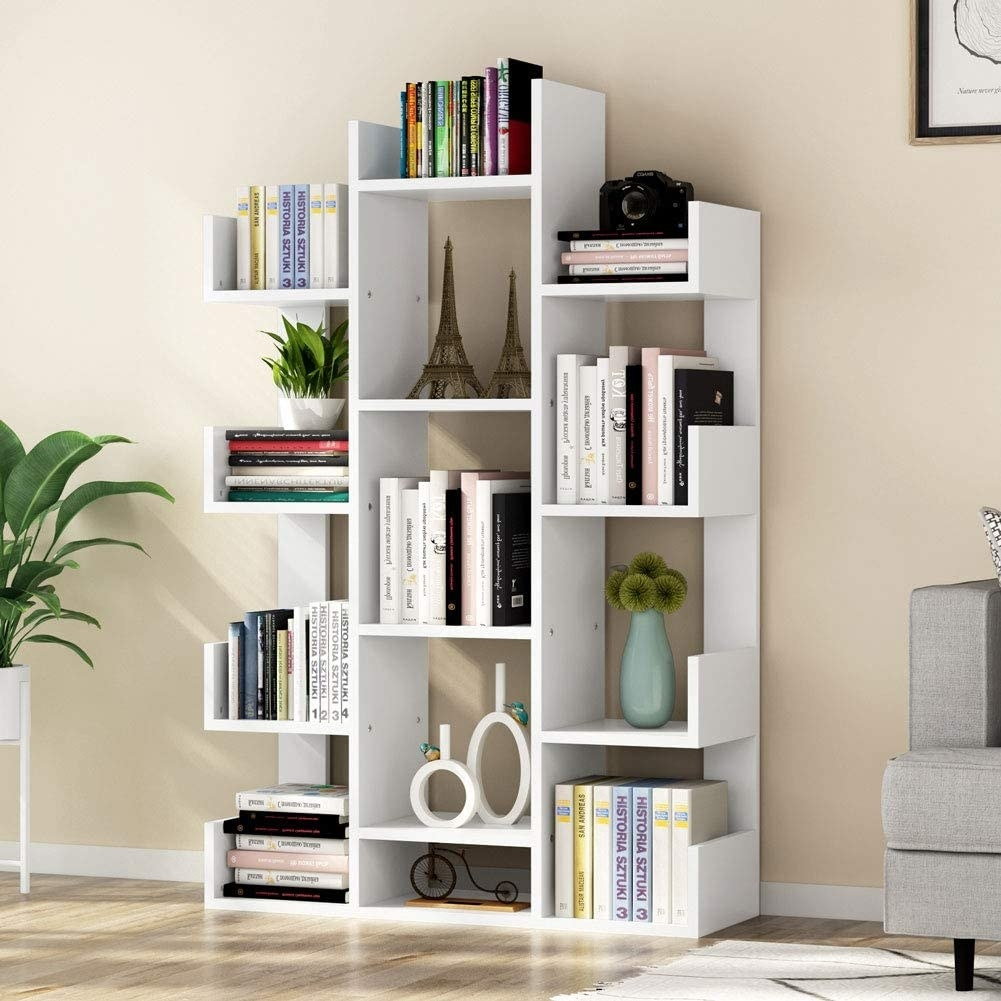white asymmetric bookcase with lots of rectangular compartments