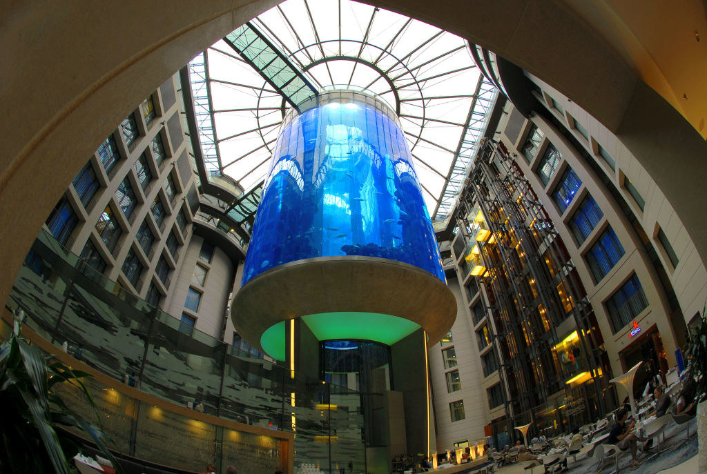 A massive aquarium that's multiple stories high in the middle of a hotel atrium