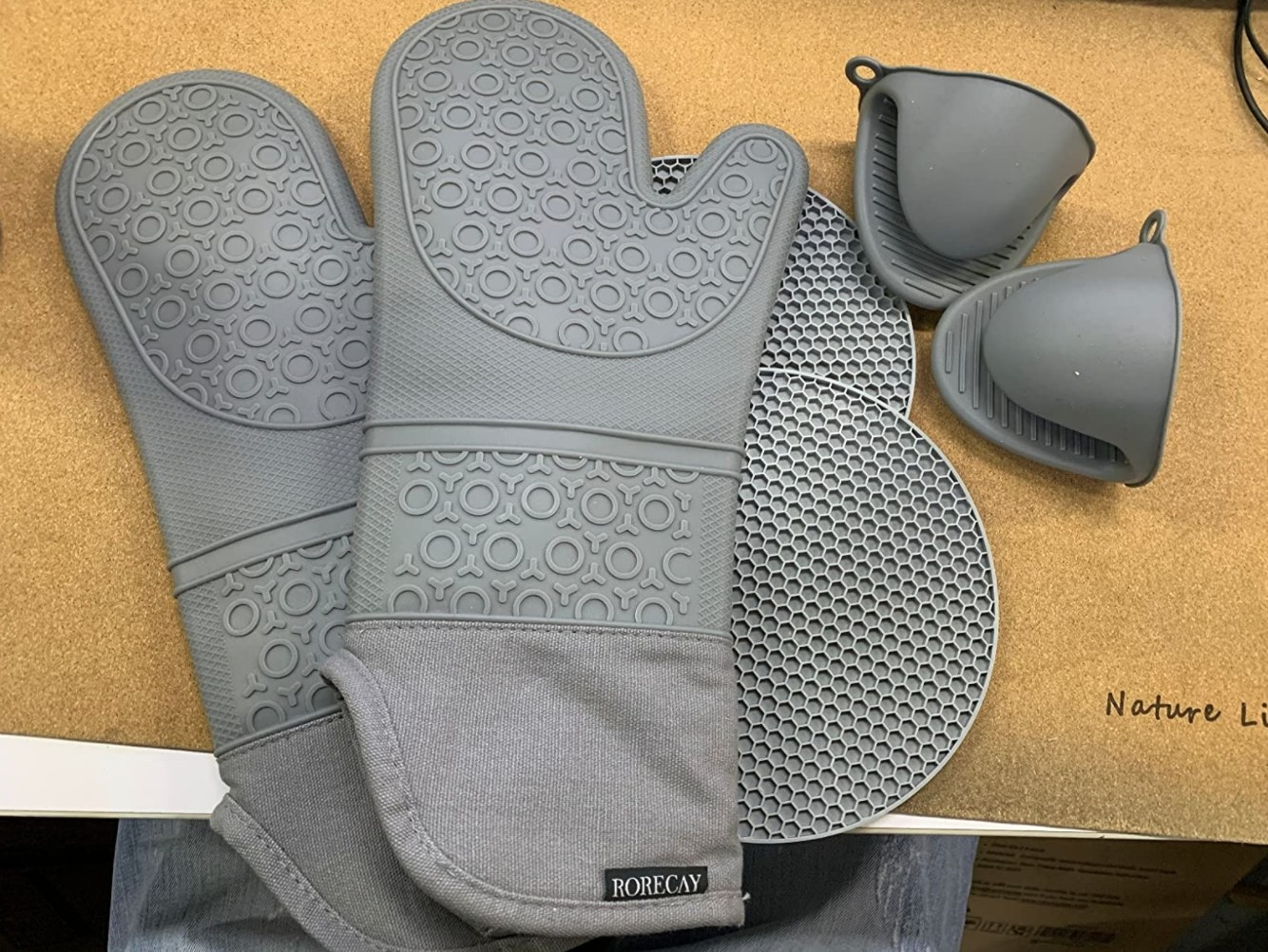 The reviewer's photo of the pack of six kitchen essentials in grey