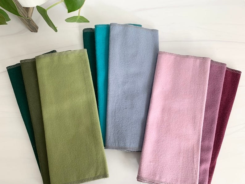 Various towels of different color on table