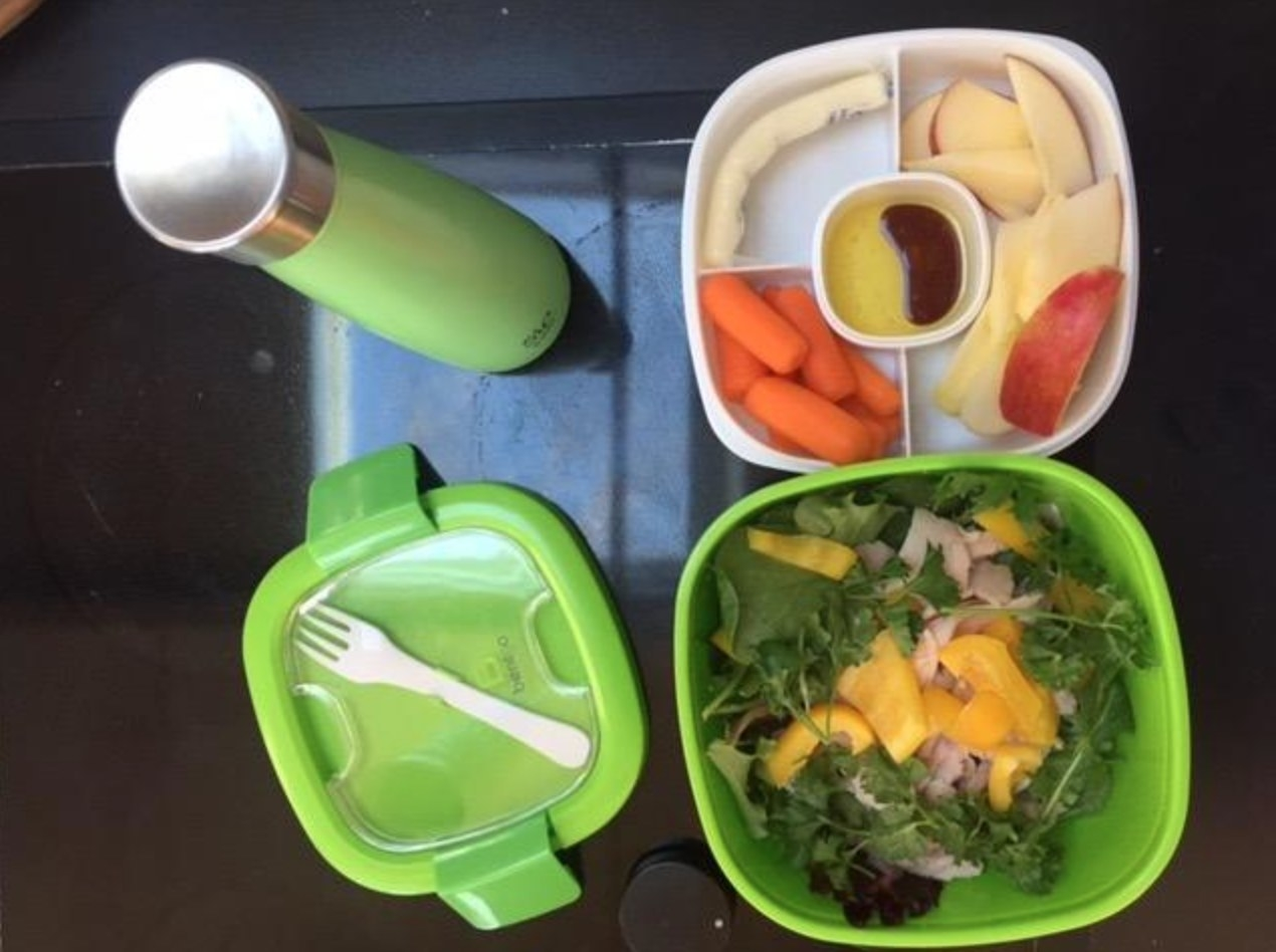 The reviewer's photo of the bento box style lunch container in green