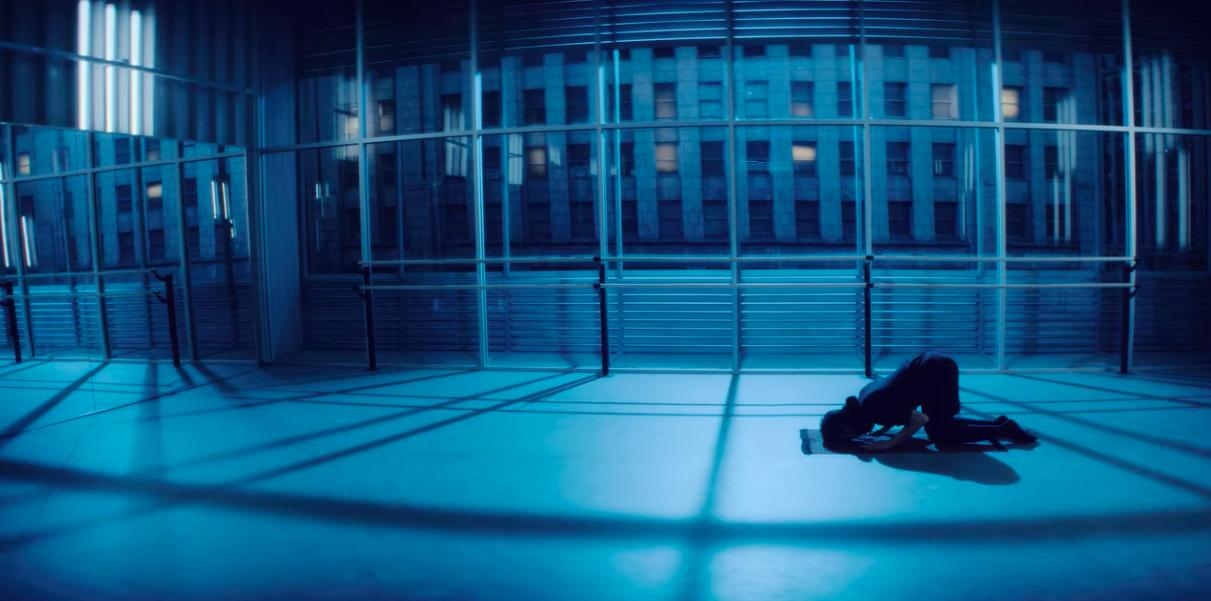 A Muslim man prays in a dance studio.
