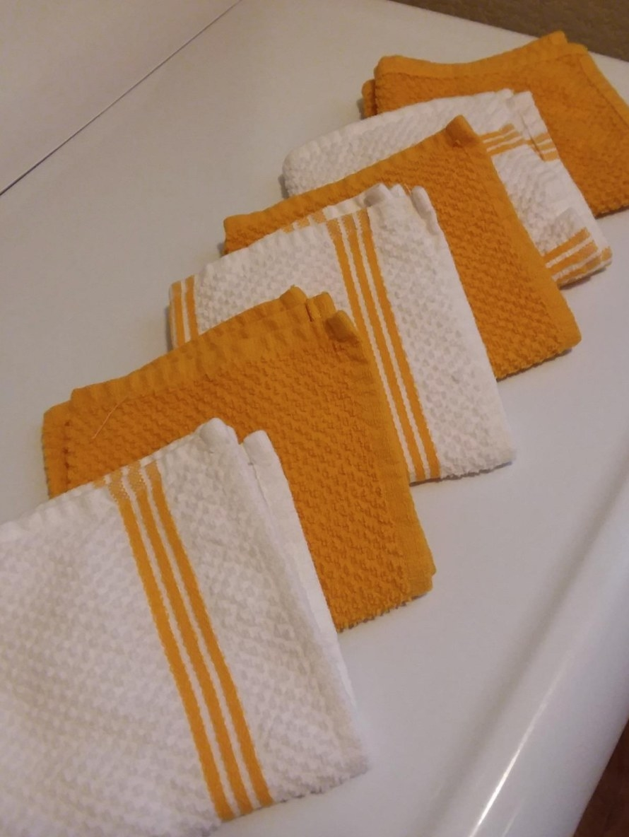 The reviewer's photo of the dishtowels in yellow laid out