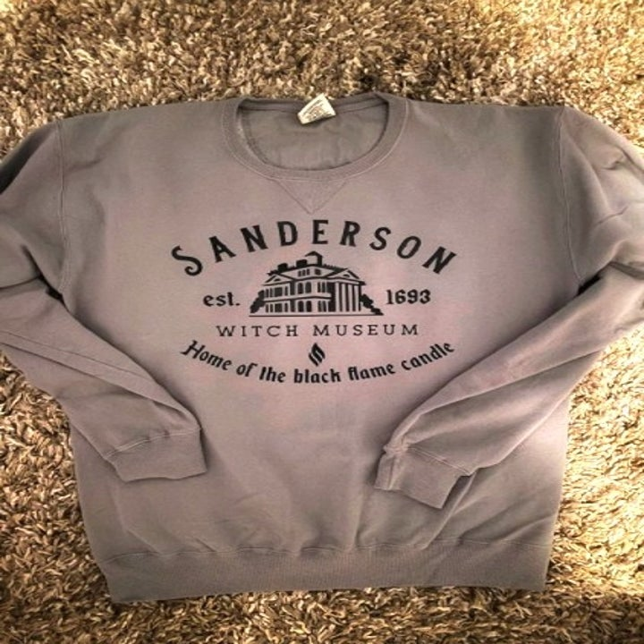 grey sweatshirt with a decal on the front