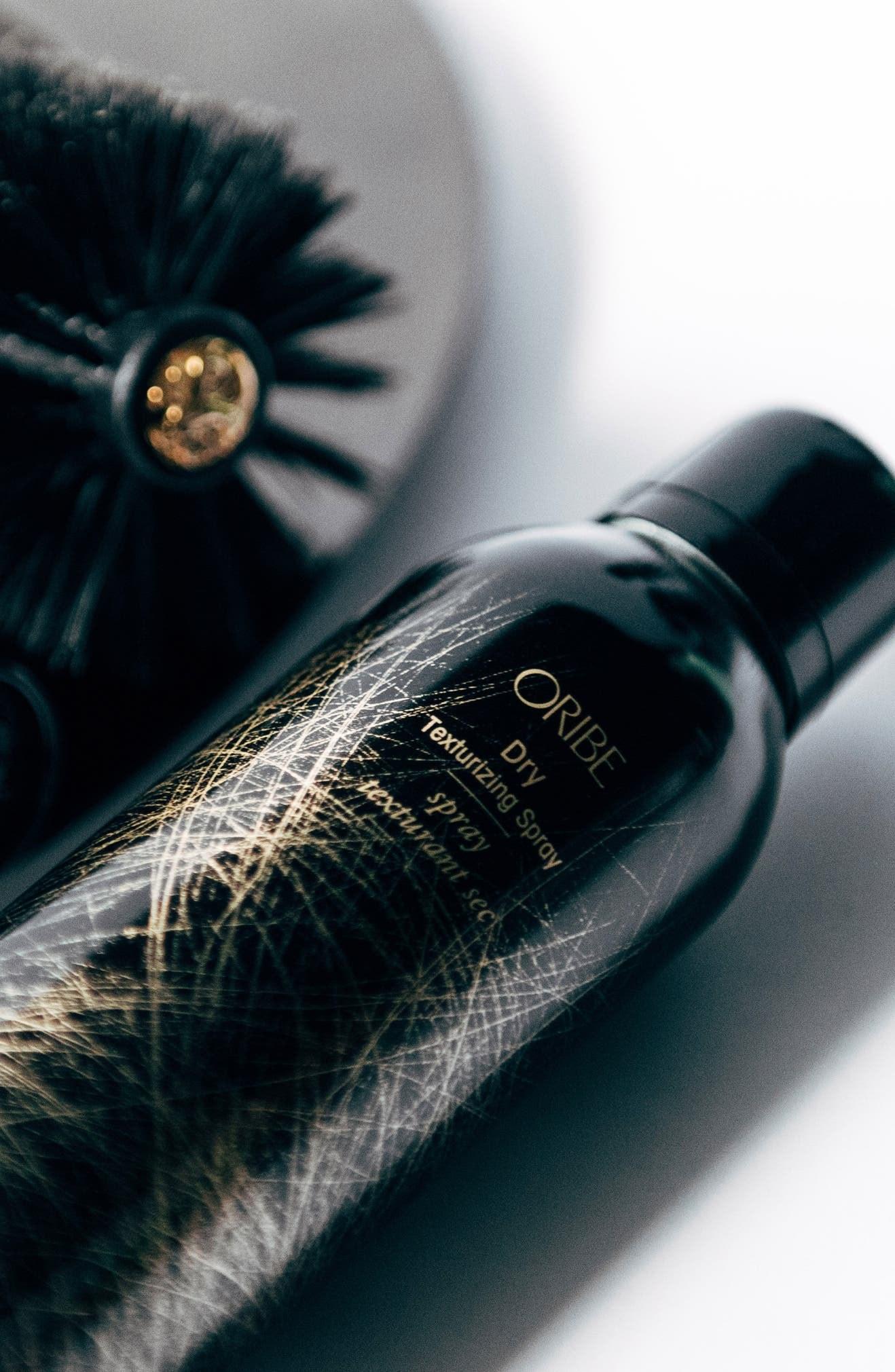 The black shampoo spray bottle