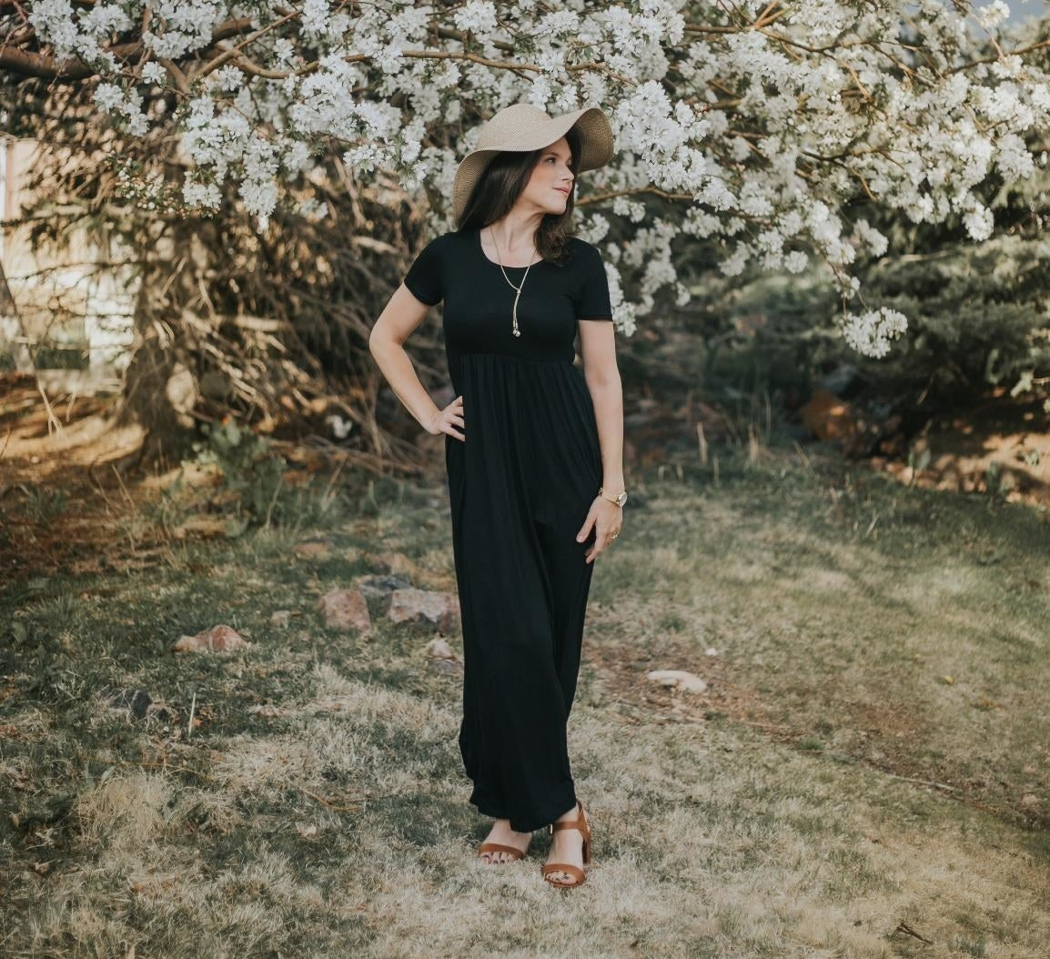 Reviewer wearing the black maxi dress