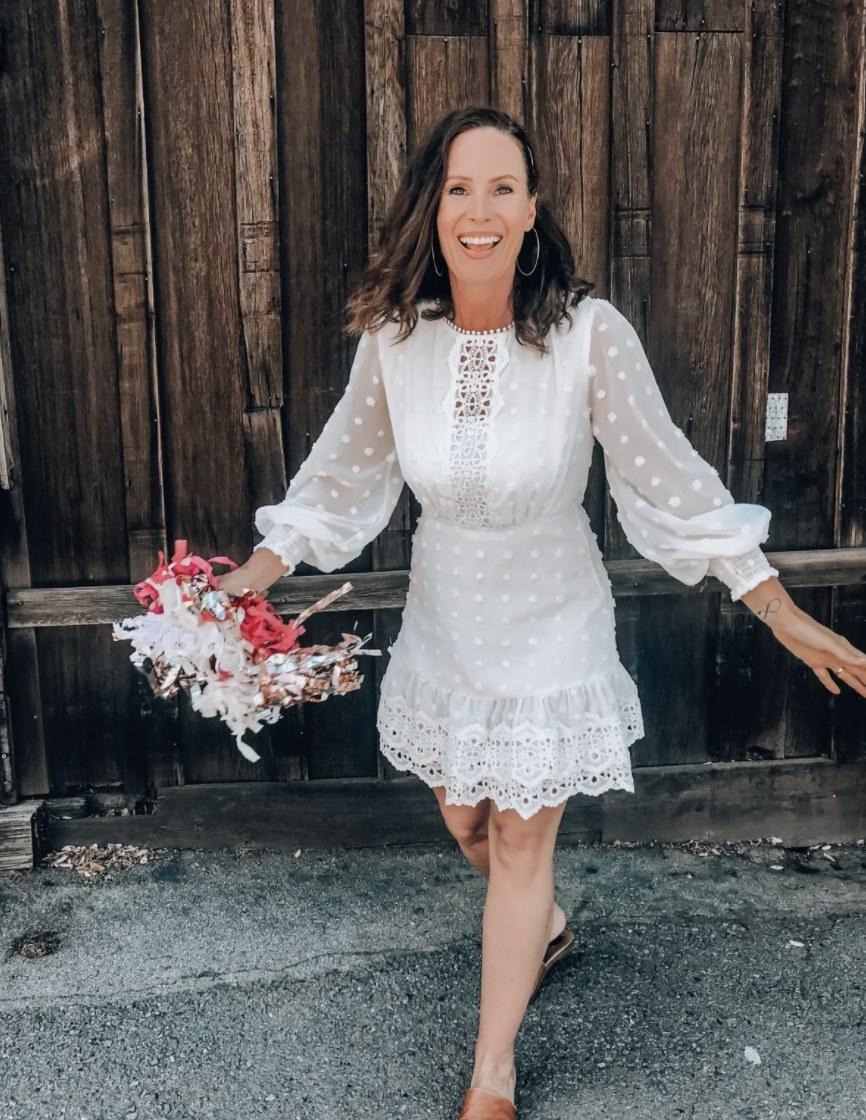 Person is wearing a white boho dress