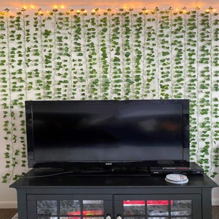 hanging fake ivy vines hung behind a tv