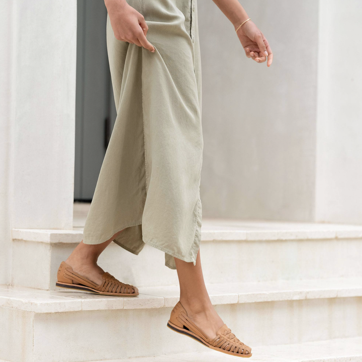 model walks in tan Huarache sandals