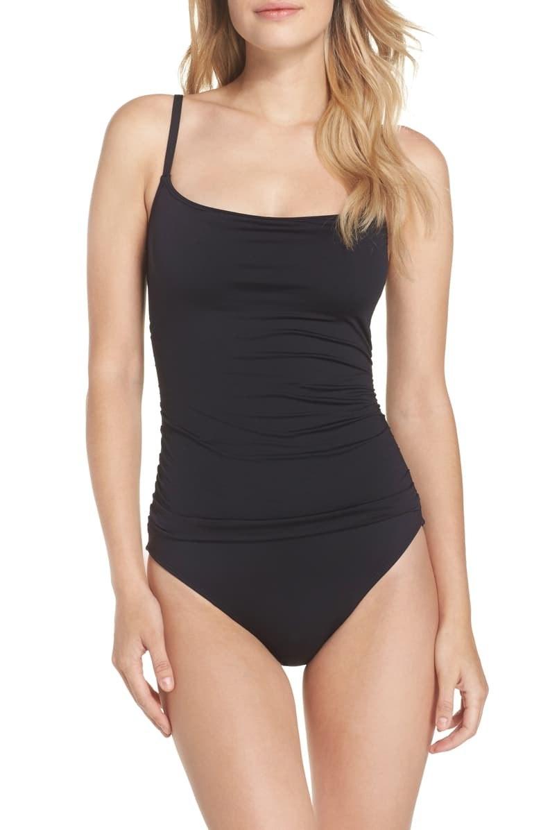 A model wears the black swimsuit