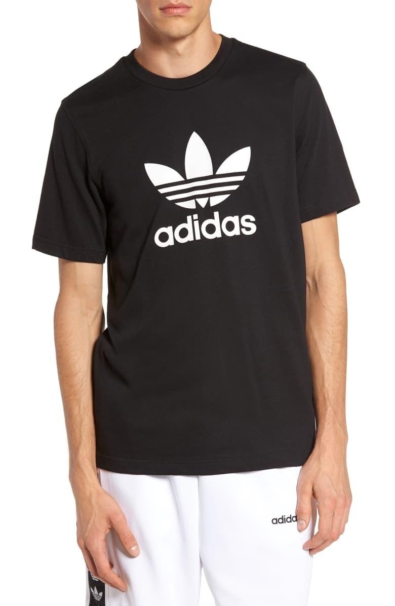 A model wears the black T-shirt