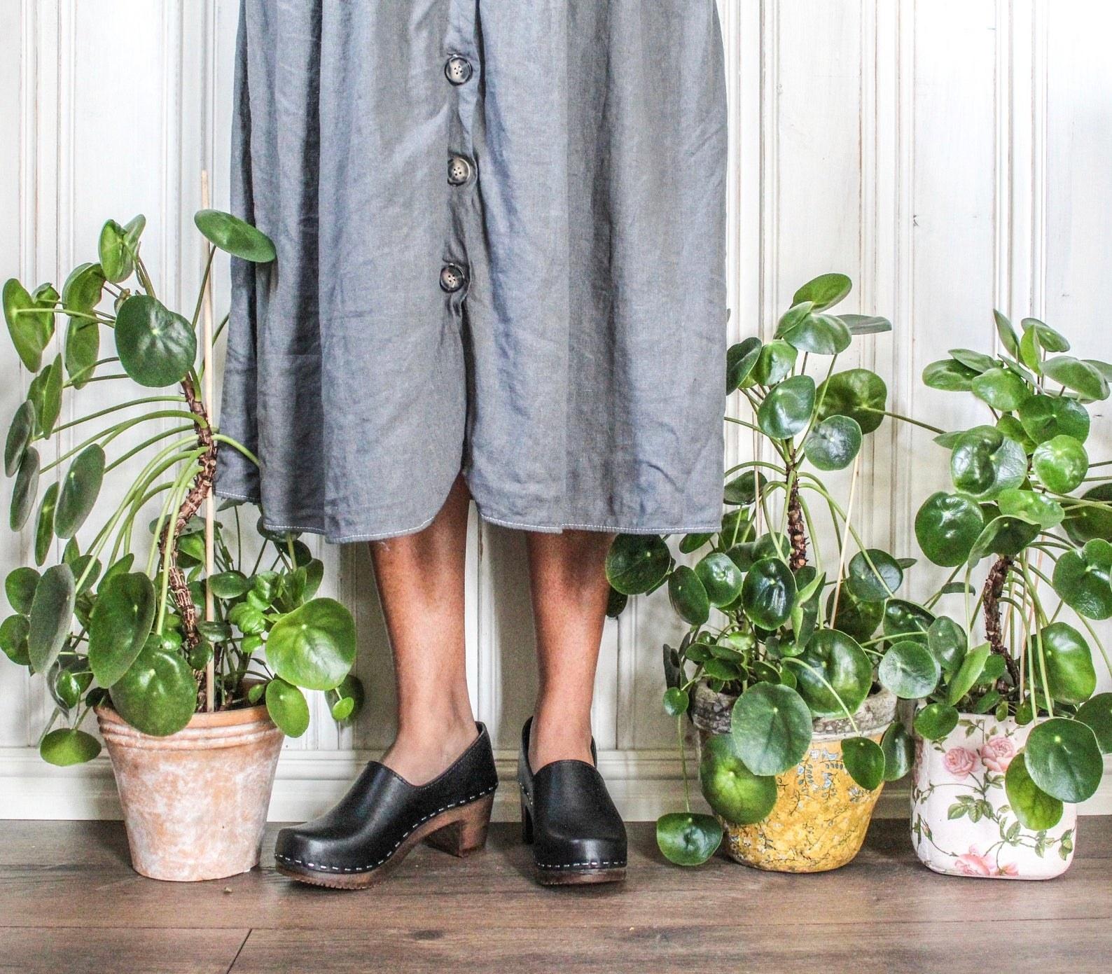 Model wearing clogs
