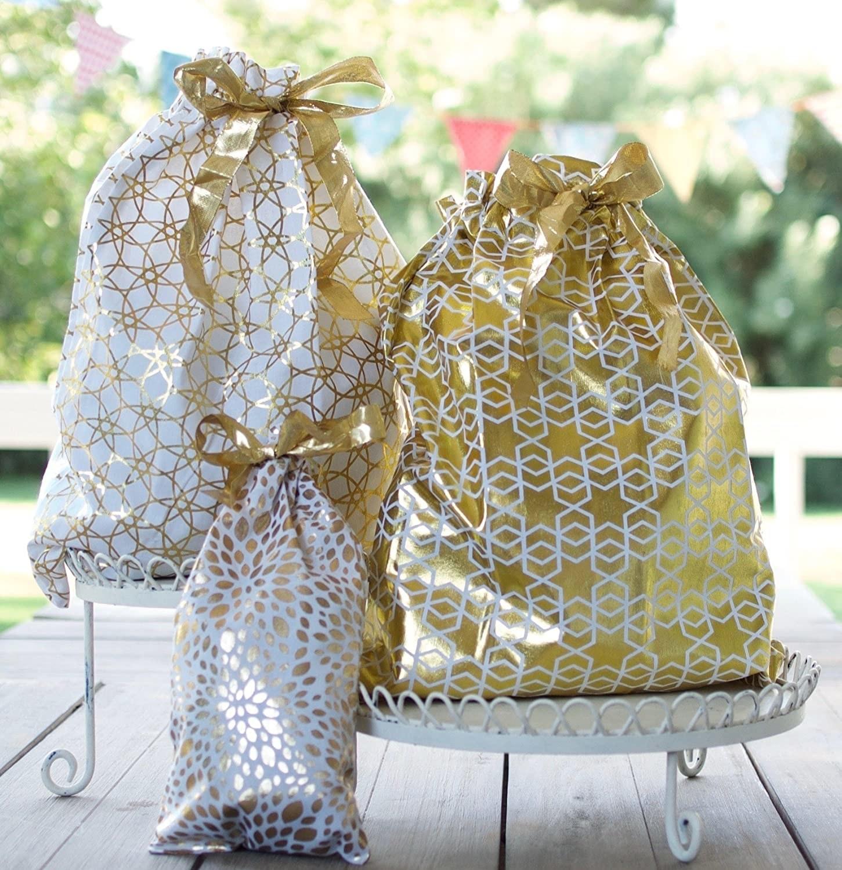 white and gold metallic gift sacks of various sizes