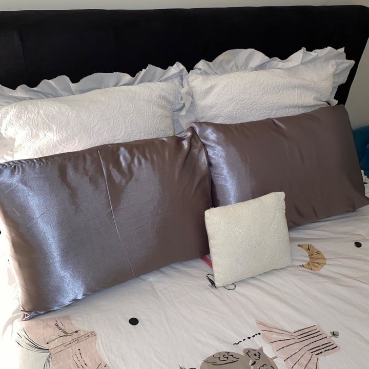 satin pillow cases on a bed