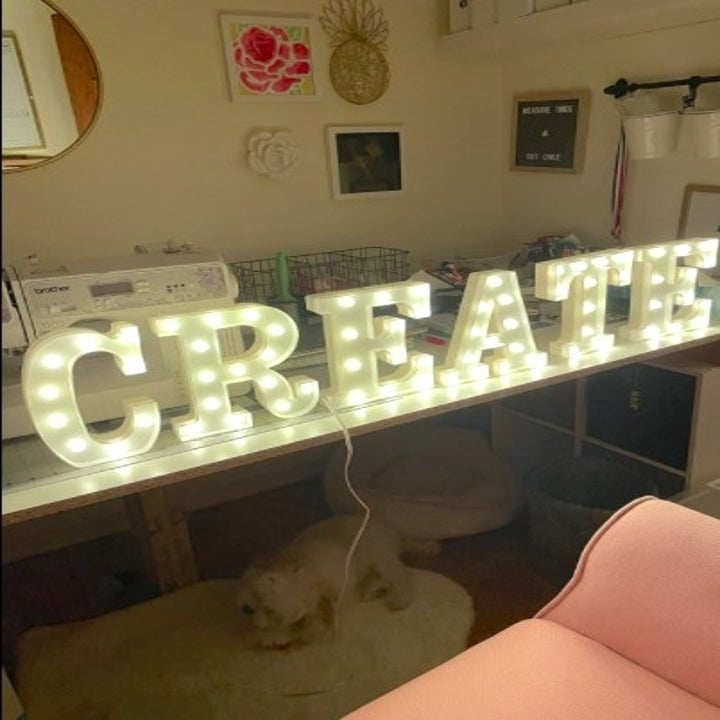 """light up letter signs spelling out the word """"Create"""""""