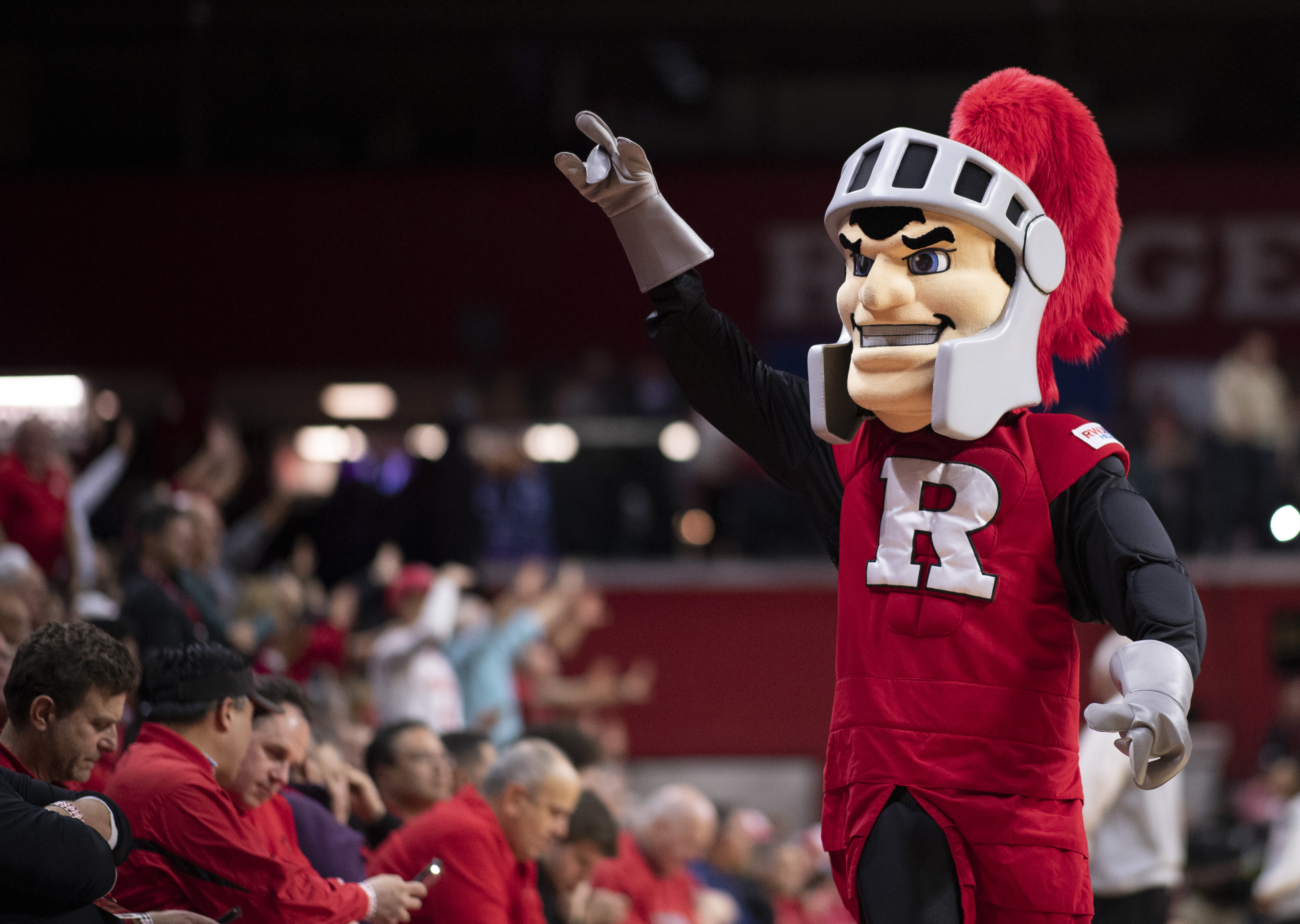 """Red-clad knight mascot with a big """"R"""" on his outfit."""